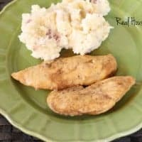 crockpot maple dijon chicken tenders with a side of mashed potatoes served on a green dish