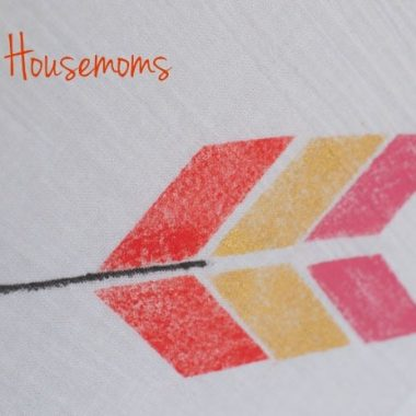 close up of diy painted bread cloth. Design is in the shape of an arrow