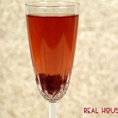 Pomegranate Spritzer served in a champagne flute