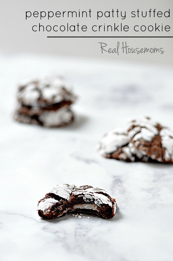 Peppermint Patty Stuffed Chocolate Crinkle Cookie | They're perfect for your Christmas plates or cookie exchange!