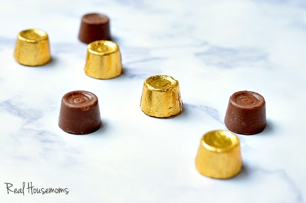 Rolo candies wrapped and unwrapped on the kitchen counter