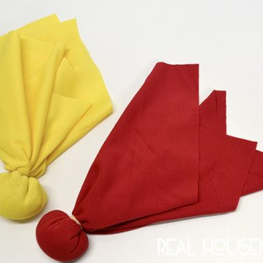 easy diy penalty flags. Yellow and red flag filled with Quinoa secured with rubberband
