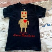 "Design your own tshirt, DIY, t-shirt design with iron on vinyl. Black Kids shirt with design of a gold robot with red heart eyes and smile. Shirt reads ""I'm just a Love Machine"""