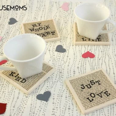 DIY Love Quote Coasters, Four coasters with very tiny writing as background and larger writting on top each coater has it's own quote, two of the four coasters have white mugs on them