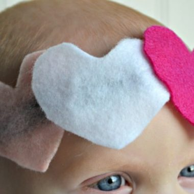 Easy Valentine Headbands for babies. Head band on babys head with three felt hearts two pink one white
