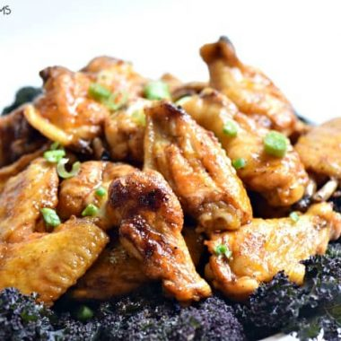 Grilled Honey Sriracha Chicken Wings. sweet and spicy. Served on a sharing plate