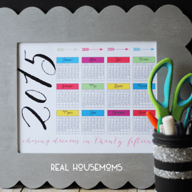 RH-2015 At a Glance Calendar-print on chalk board with gray boarder, Mason jar full of pens and a pair of scissors off to the side of calender
