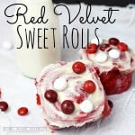 Red Velvet Sweet Rolls. topped with white frosting and red and white M&M'S. with a side of milk