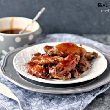 Root Beer Chicken Wings, served on a white dish with a side of sweet and sticky sauce