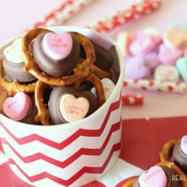 valentine pretzel bites. Pretzels topped with chocolate topped with Sweethearts. served in a festive valentine bucket
