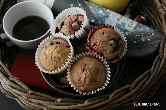Chocolate Berry Muffins. wicker basket filled with hot coffee, apple, magazine, and juice