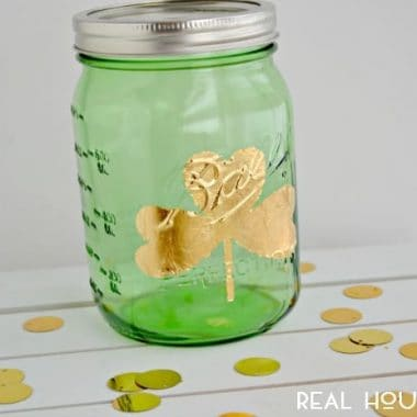 Gold Leaf shamrock Mason Jar .Green Mason jar with gold leaf shamrock on it.