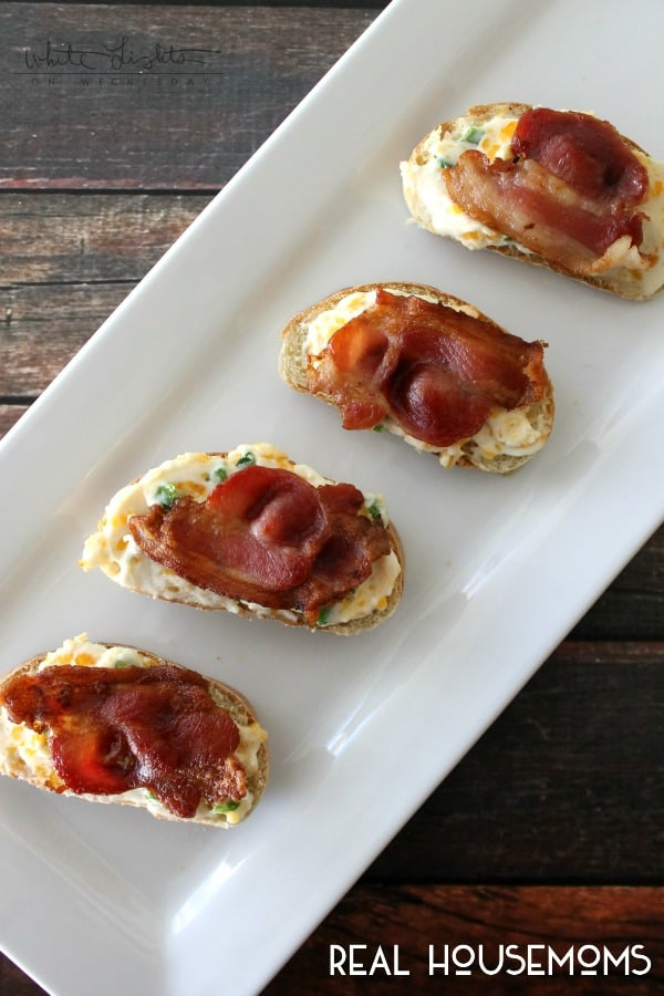 Jalapeno Popper Bruschetta. Served on minni bread topped with bacon. served on a white serving tray