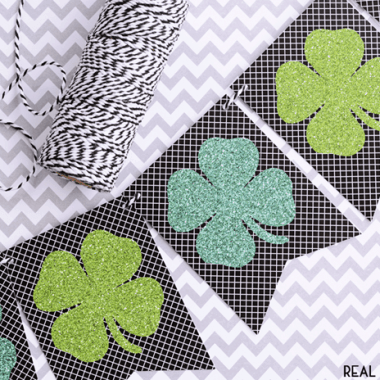 shamrock banner printable. black and white background with shamrocks on the front. Shamrocks are two different green colors