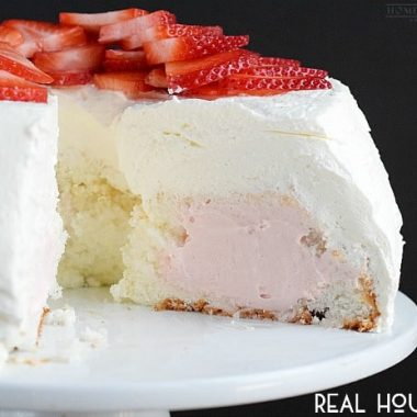 This light and fluffy angel food cake is filled with delicious strawberry cream and frosted with homemade whipped cream. A light and refreshing cake recipe for summer.