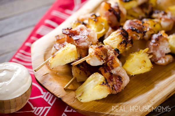 Bacon Wrapped Shrimp and Pineapple Kabobs are served with a creamy Greek yogurt and szechuan sauce for a light and easy dinner recipe perfect for summer grilling season!