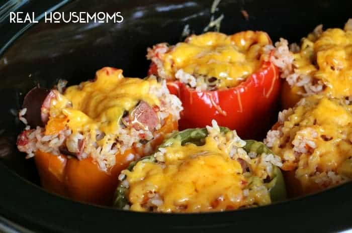 Slow Cooker Sausage and Rice Stuffed Peppers are a new way to stuff peppers! Surprise the family with this delicious dish!