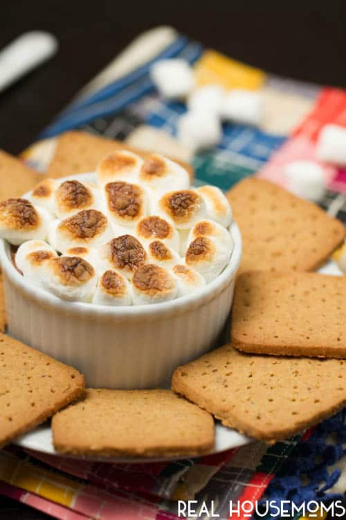 Easy, chocolate-y and sinful brownie batter s'mores dip gives you everything you love about the summer classic in party dip form!