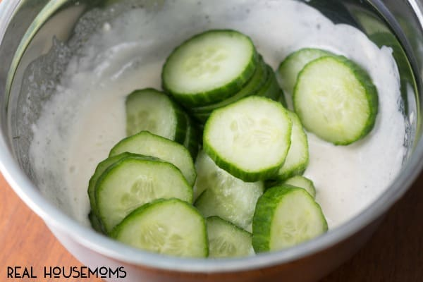 Need a simple, healthy and delicious side dish? These creamy cucumbers will be everyone's favorite at your next BBQ!