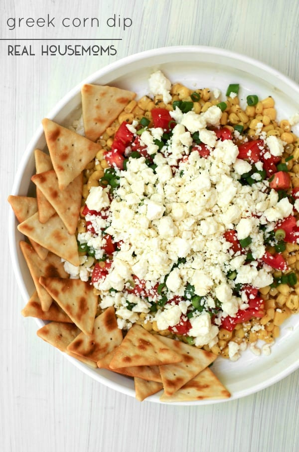 Greek Corn Dip is a Mediterranean inspired cold dip that features sweet corn, feta cheese, and a bold Greek dressing!