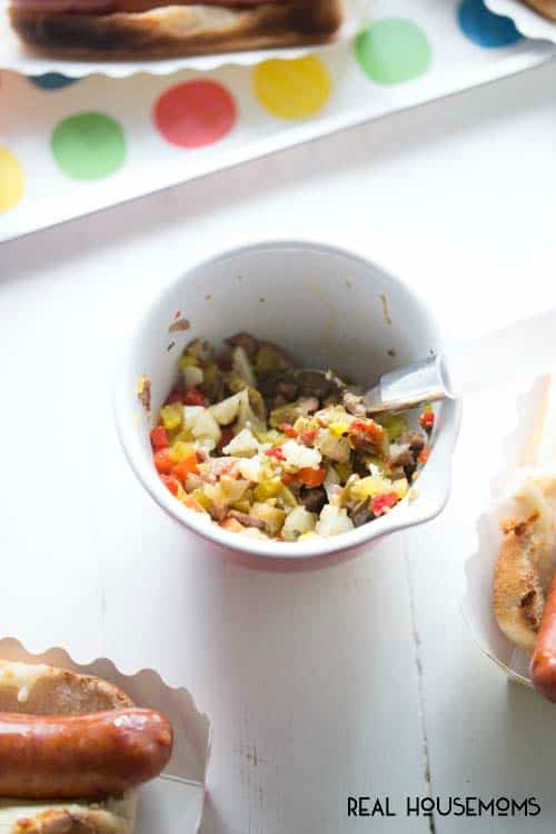 This Muffaletta Hot Dog is a great way to spruce up a BBQ staple!