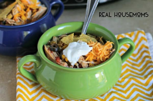 Slow Cooker Chicken Taco Soup is a dump and go soup recipe that can be made decadent or healthy with the toppings!
