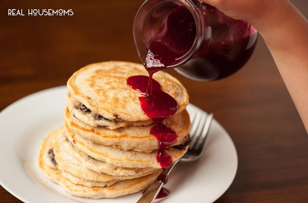 Homemade Raspberry Pancake Syrup made from fresh or frozen raspberries is a decadent breakfast treat and is excellent on chocolate chip pancakes.