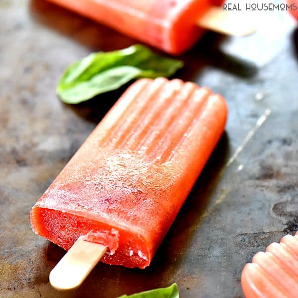 Boozy Strawberry Basil Lemonade Popsicles are crazy awesome out of this world good!!!  I love to let them melt in my summer cocktails too!