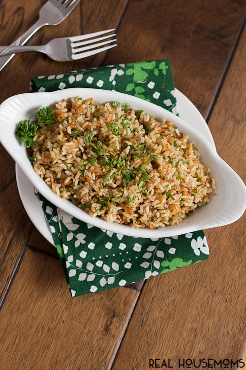 Brown rice gets a makeover with garlic and fresh herbs then baked until perfectly fluffy - this baked brown rice will be your new side dish staple!