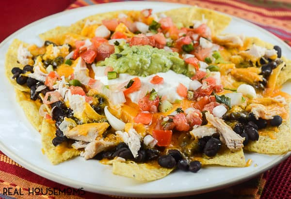 Easy Chipotle Chicken Nachos are a seriously delicious appetizer with spicy chicken that's ready to eat in 10 minutes!