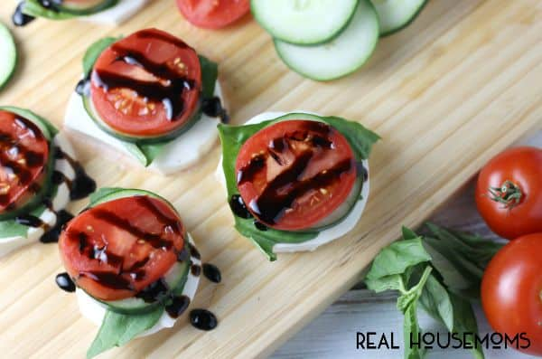 Fresh mozzarella, hand torn basil leaves, crisp cucumbers, a slice of campari tomato, and balsamic glaze make for easy and fresh Garden Caprese Stacks!
