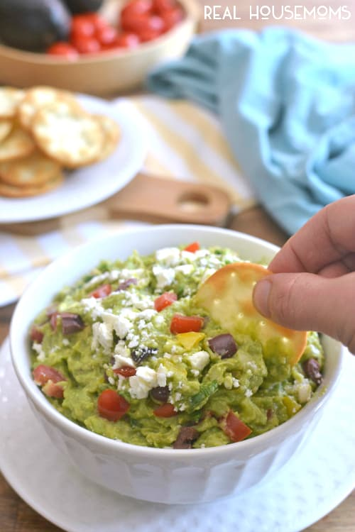 Mediterranean Guacamole combines some of my favorite flavors into one delicious dip! It's a fun twist on the original, and perfect for summer entertaining!!