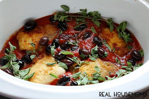 Break out your crockpot to make this Slow Cooker Mediterranean Chicken! Chicken thighs slow cooked with tomatoes and olives for a easy dinner that is ready when you get home!