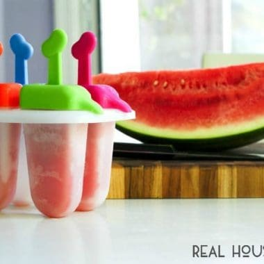 Boozy Watermelon Pops are sweet adult-only watermelon popsicles spiked with watermelon flavored vodka!