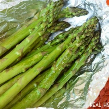 Easy Grilled Asparagus is the perfect side dish when you're grilling! Takes seconds to throw together, no mess, no fuss, and delicious!