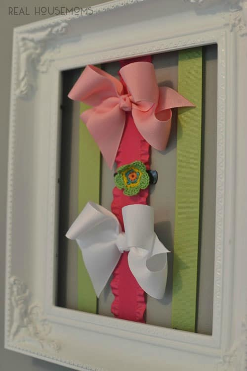 Get your little one's hair accessories organized with this easy Picture Frame Hair Bow Holder!