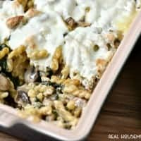 Roasted Mushroom Spinach Sausage Alfredo Pasta Bake tastes out of this world!! It's our new favorite Sunday dinner!