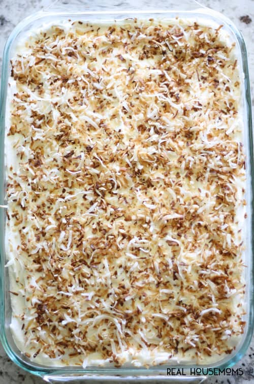 Toasted Coconut Poke Cake is a great make ahead dessert for serving a crowd!
