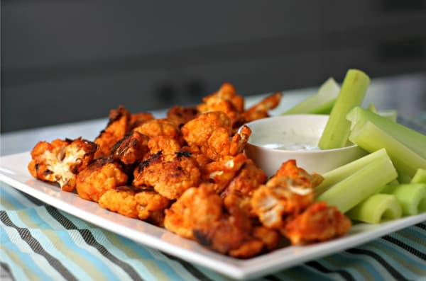 Buffalo Cauliflower Bites are one spicy (and secretly healthy) appetizer, perfect for game day!