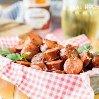 Sweet and Spicy Slow Cooker Kielbasa Bites are the perfect crowd pleasing snack for your next tailgate!