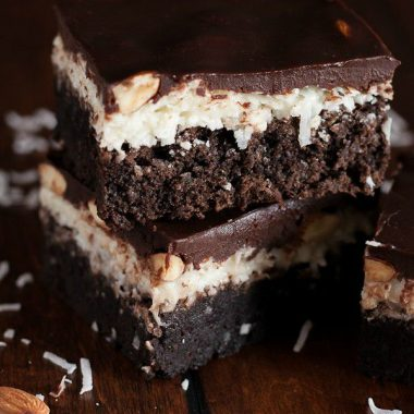 Decadent fudgy Almond Joy Brownies have a layer of sweet coconut filling and crunchy almonds, all topped with a layer of chocolate ganache. The perfect brownie for any Almond Joy lover!
