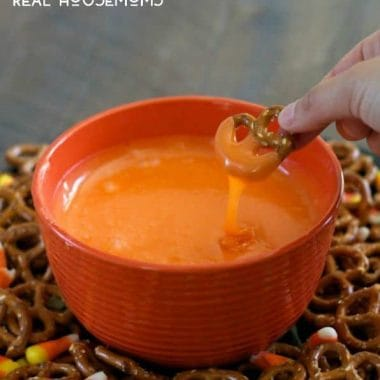 Serve this sweet Slow Cooker Candy Corn Fondue with salty pretzels for a fun Halloween treat!