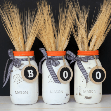If you're looking for a quick and easy Halloween centerpiece idea or simply a little festive decor for your mantel, these Halloween Mason Jar Vases are it!