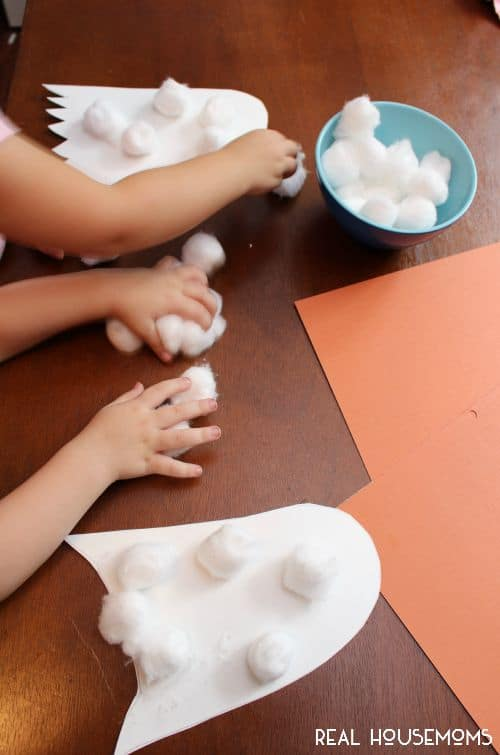 Halloween Cotton Ball Ghosts are an easy and fun project to get little ones excited for Halloween!