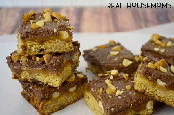 Peanut Butter Salted Caramel Bars are rich, chewy and oozing with salted caramel and peanut butter! Can you see the layers??? Yum!