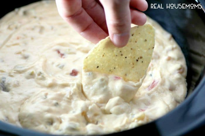 This fantastic Slow Cooker Queso Dip is an easy crowd pleaser that's nice and warm for when the days start to get cooler!