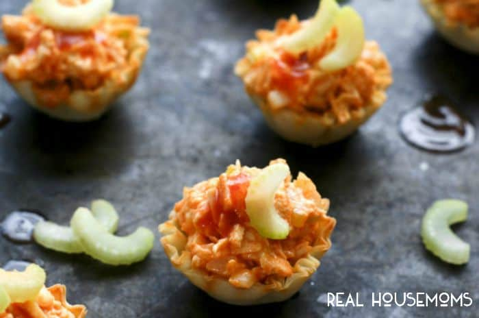 Buffalo Chicken Salad Bites are the perfect bite-sized appetizer featuring spicy buffalo chicken salad served in crisp phyllo shells!