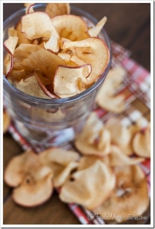 DIY Baked Apple Chips: These crispy baked apple chips make the perfect Fall snack! They are healthy, easy to make, and crazy addicting to snack on!
