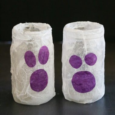 These mason jar ghost luminaries are an easy craft to do with the kids and perfect for Halloween night!