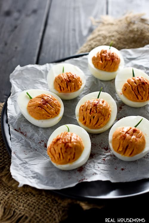 Halloween Pumpkin Deviled Eggs are totally cute, fit the occasion perfectly and taste great, too!